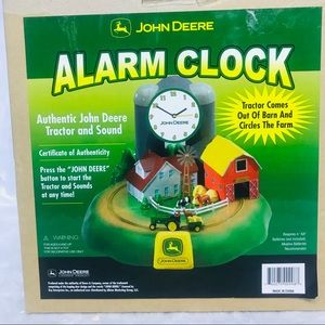 New John Deere  Alarm Clock Tractor comes out Barn